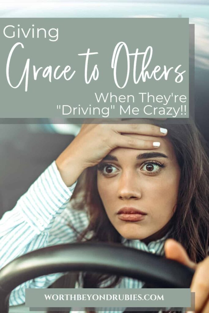 """An image of a woman sitting behind the wheel of her car with one hand on the wheel and one on her head with a look of disbelief on her face and text that says Giving Grace to Others When They're """"Driving"""" Me Crazy!!"""