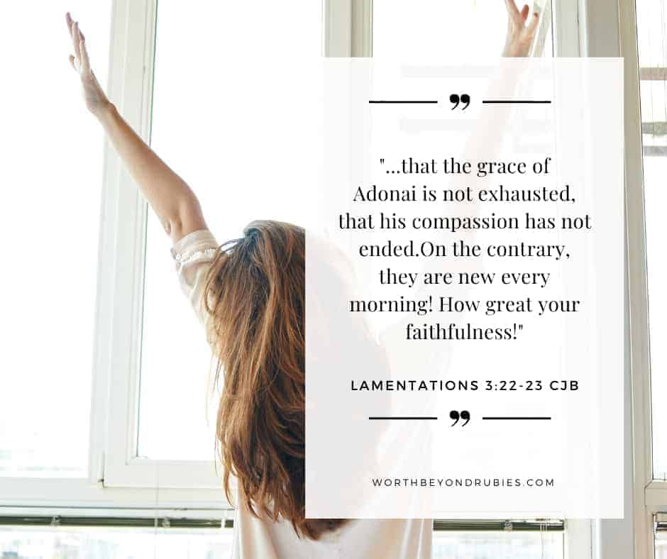 An image a woman with long brown hair sitting up in bed facing windows with her arms up stretching and Lamentations Lamentations 3:22-23 CJB quoted - Giving Grace