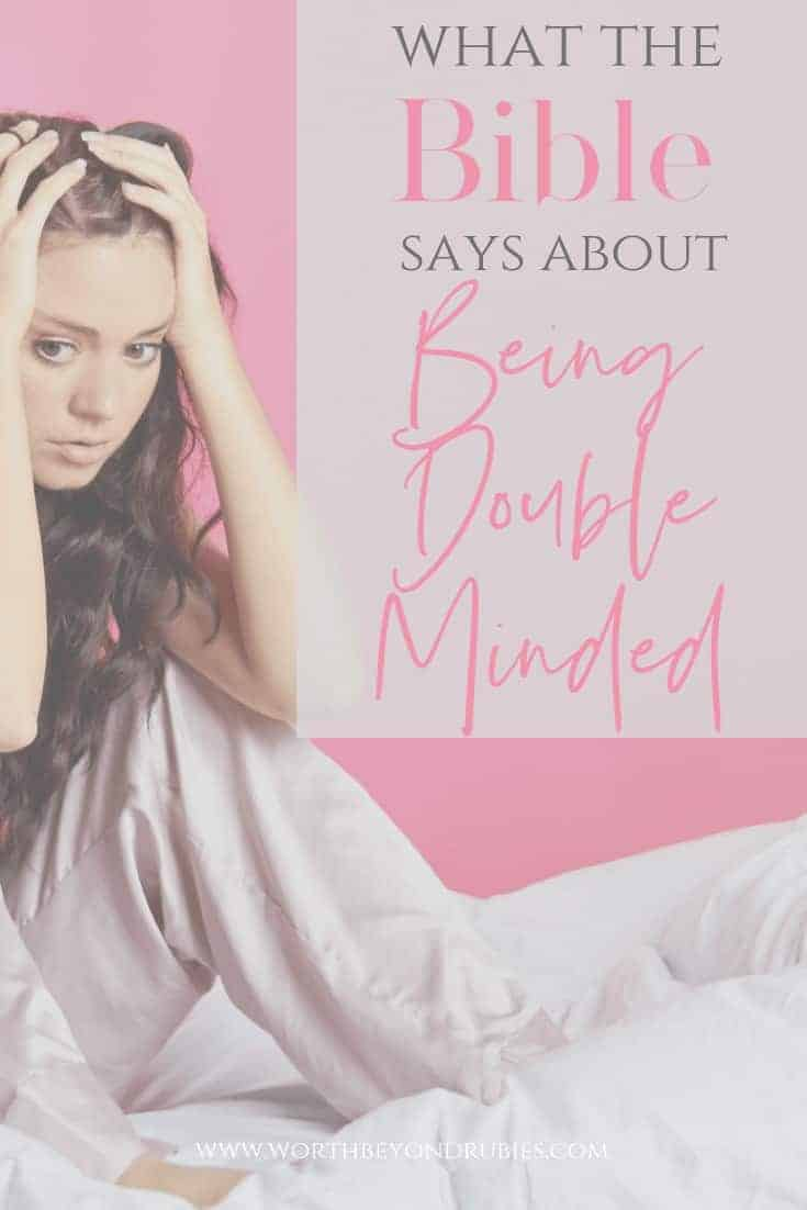 How to Stop Being Double Minded - A confused looking woman sitting on a bed in her pajamas in front of a pink wall