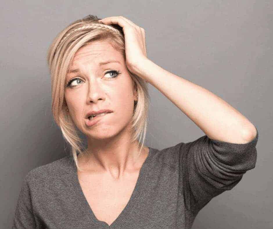 Breaking the spirit of fear - a blonde woman looking worried