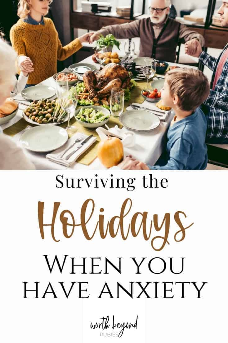 an image of a family gathered around the table at Thanksgiving dinner and a text overlay that says Surviving the Holidays When You Have Anxiety