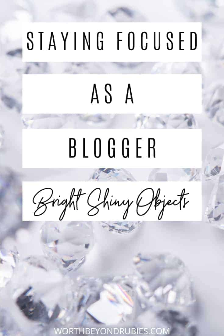 An image of a large grouping of diamonds on a white background and text that says Staying Focused as a Blogger - Bright Shiny Objects