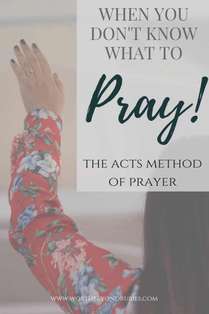 """A woman praying with her arms raised and a text overlay that reads """"When you don't know what to pray - the ACTS Prayer Method"""""""