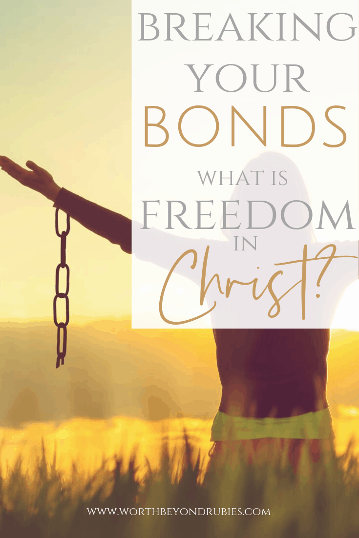 What is Freedom in Christ? A woman standing at sunset with broken chains on her arms