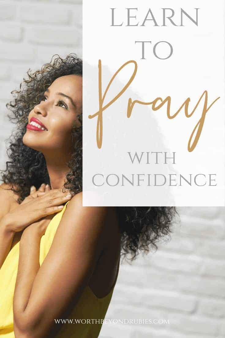 Pray with Confidence - ACTS Prayer Method - A woman with her arms across her chest looking up at the sky smiling with a white brick wall behind her