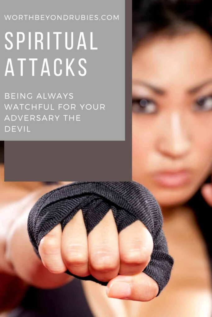 An image of a woman with a fist extended in boxing wraps and a text overlay that says Spiritual Attacks – Be Watchful for Your Adversary the Devil