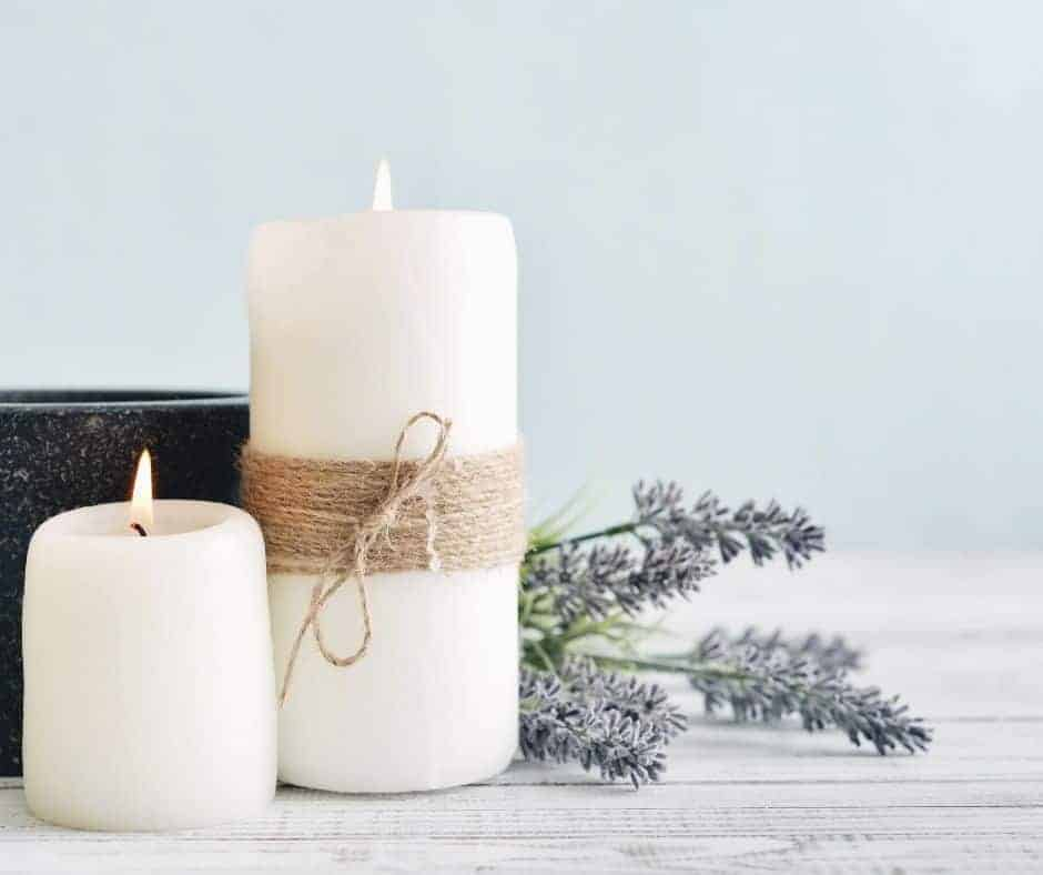 The Power of the Word of God - an image of two pillar candles with lavender alongside them