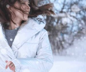 God Intended for Good - A woman in a white winter coat shaking her hair