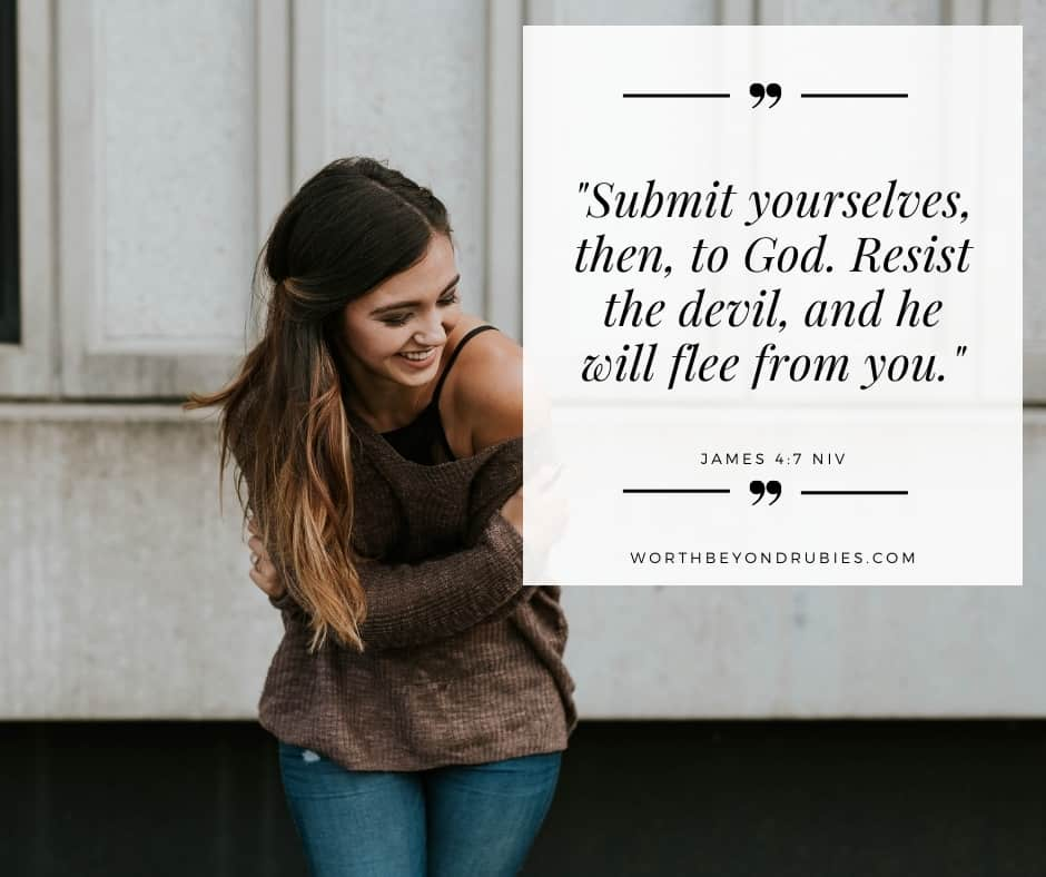 A woman with her arms around herself laughing and James 4:7 quoted in the NIV