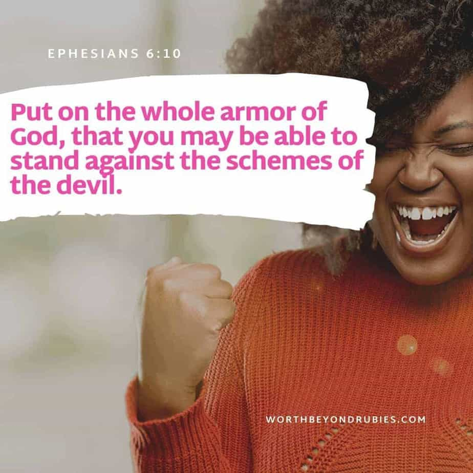 Put on the Armor of God - A pretty black woman smiling like she is excited and a Bible verse on the armor of God (Ephesians 6:10) on the image
