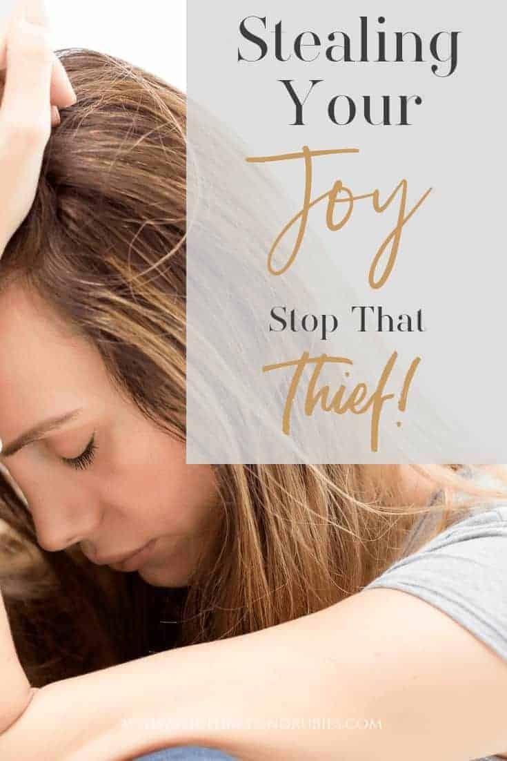 Stealing Your Joy - Stop That Thief - A woman with her head in her hand looking sad