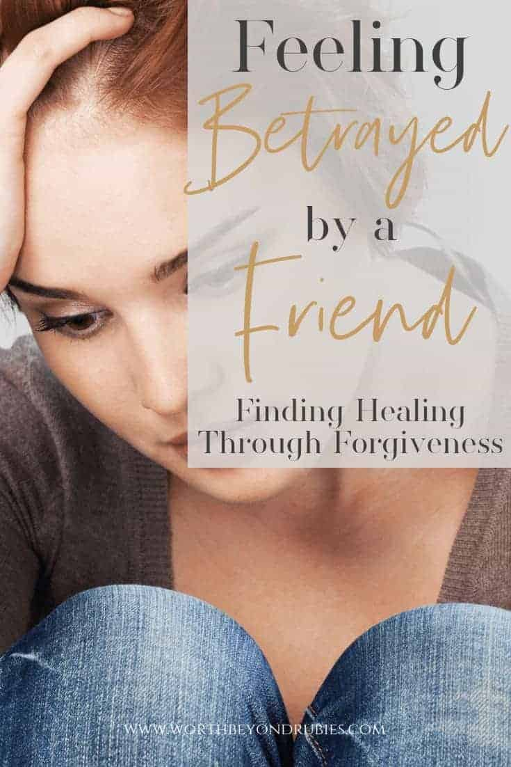 Feeling Betrayed by a Friend - Forgiveness is for you! - A woman with her hand on her head looking sad