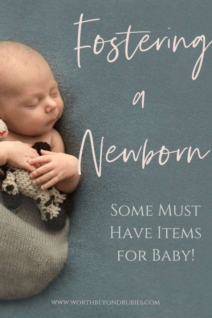 an image of a sleeping newborn and text that says Fostering a Newborn: Some Must Have Items For Baby!