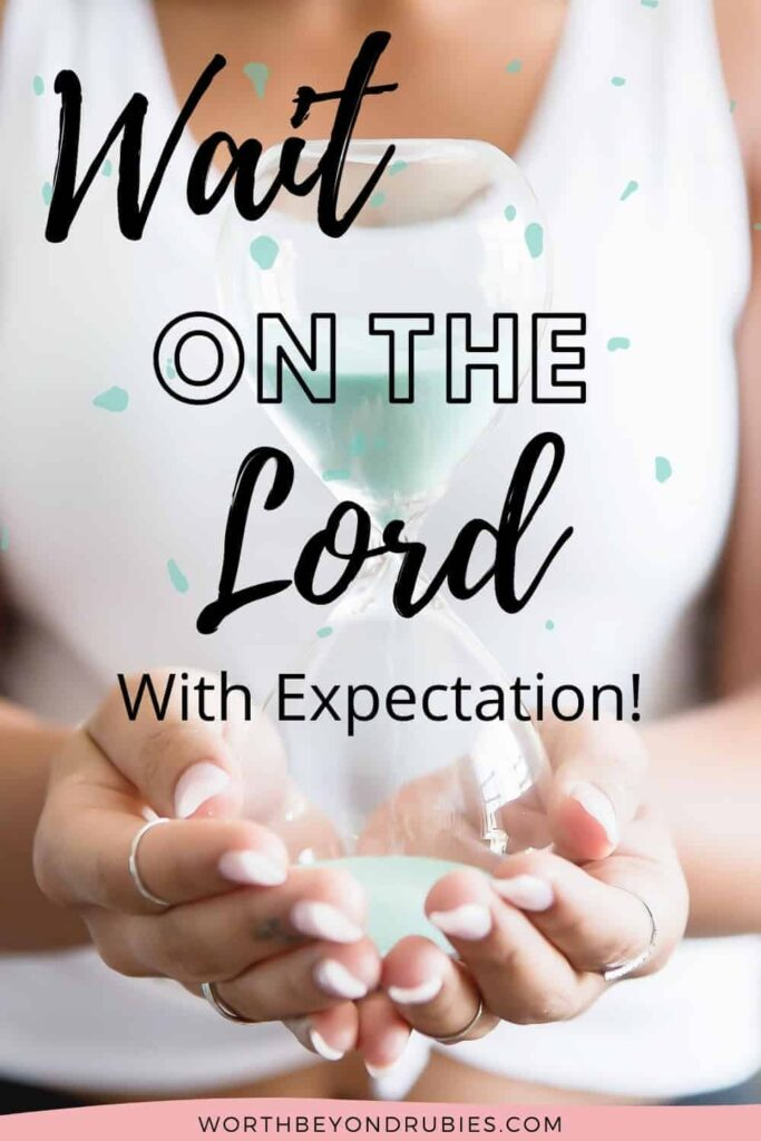 An image of a woman in a white sleeveless top holding an hourglass with light blue sand in it with a text overlay that says What Does it Mean to Wait on the Lord Expectantly?