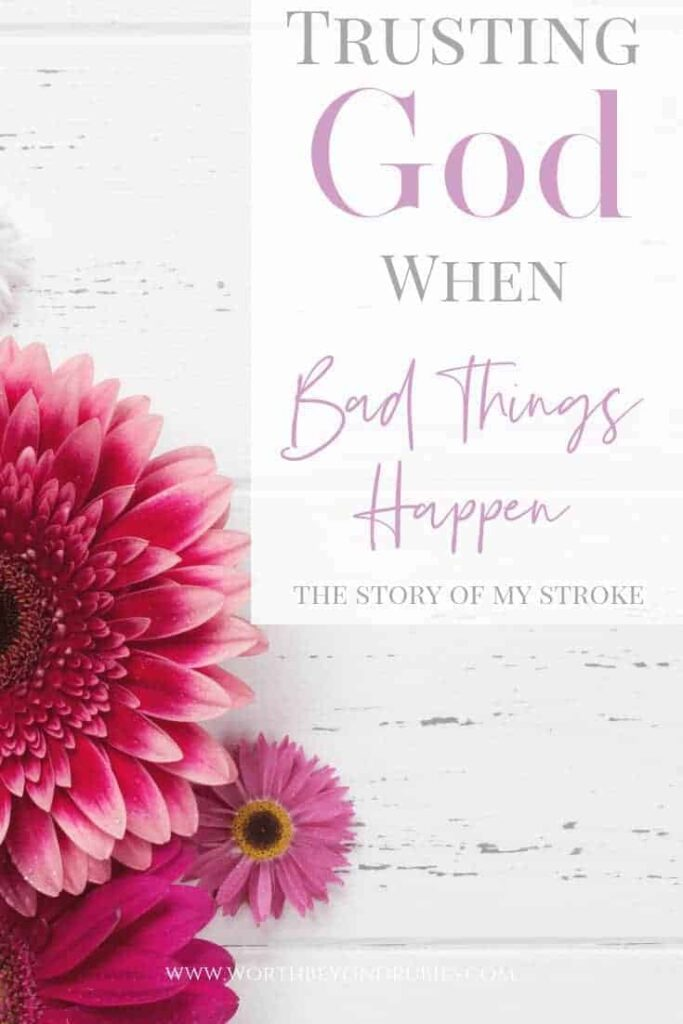 How to Trust God When Bad Things Happen - Pretty pink flowers on a white washed wood background