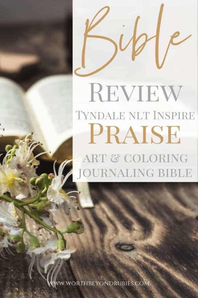 Bible Review of Tyndale NLT Inspire Art & Coloring Journaling Bible - An image of a bible in the background with flowers in the front on a wooden desk