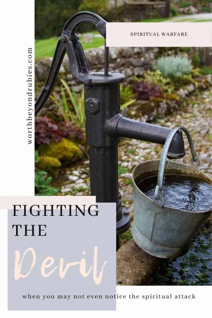 Fighting the Devil - Spiritual Attack - an image of a well pump with a bucket hanging on it