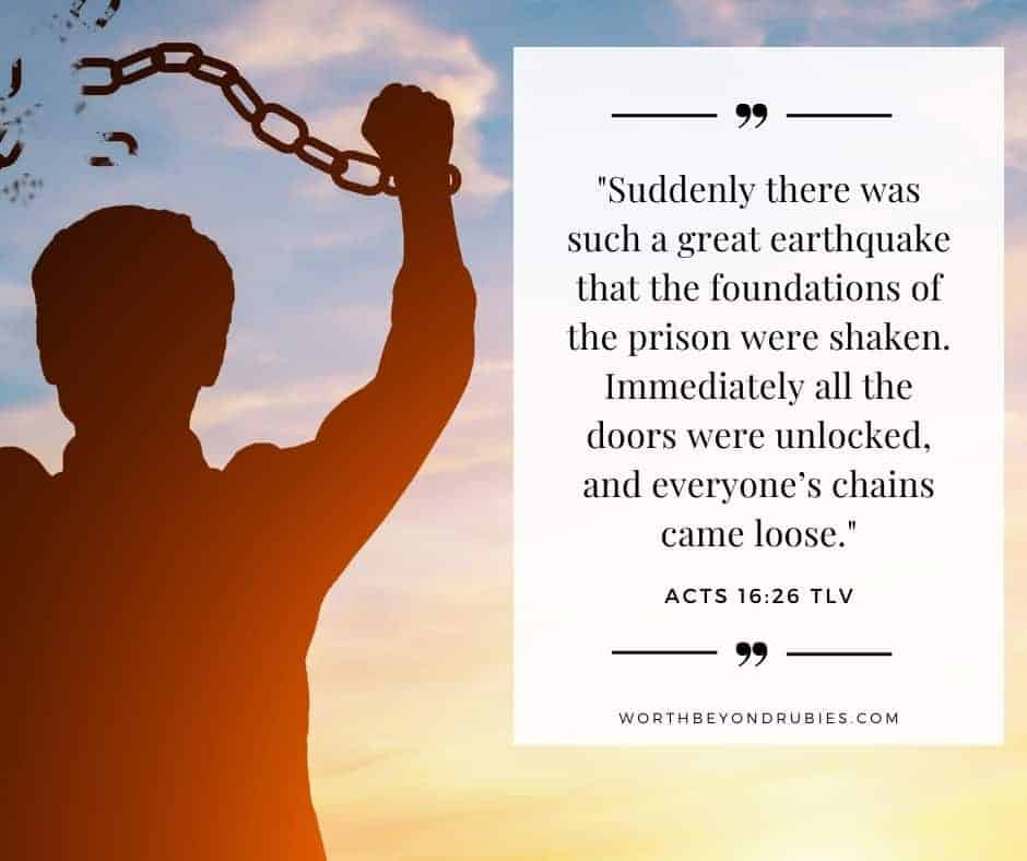 Silhouette image of a man with broken chains on his arms and Acts 16:26 quoted in Tree of Life version
