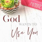 God Wants to Use You - Encouraging Others: A white, wooden table with a plant and a red Bible