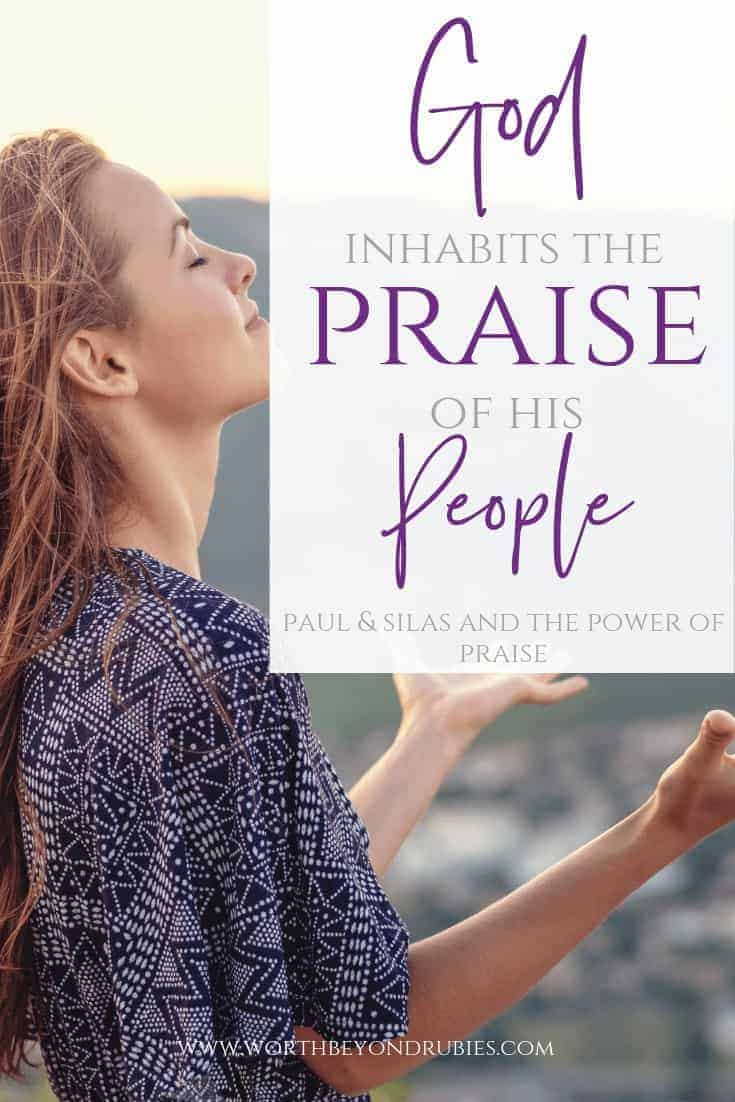 God Inhabits the Praise of His People - Paul and Silas in jail - the power of praise as Paul and Silas Prayed - Image of a woman in purple with her eyes closed and her hands raised up in praise
