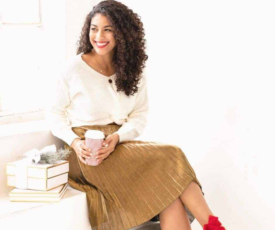 Knowing Who You Are In Christ - A woman in a brown skirt with red shoes sitting on a windowsill with a cup of coffee