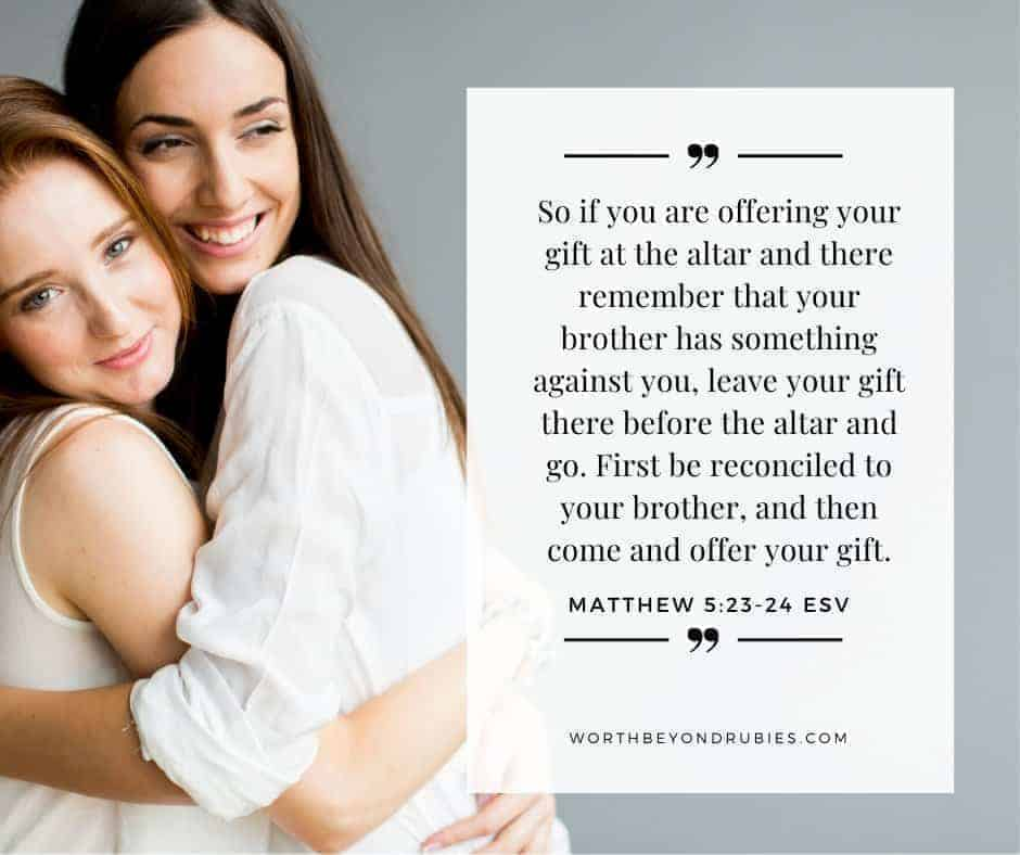 Two female friends hugging eachother with Matthew 5:23-24 quoted for post What is the Day of Atonement