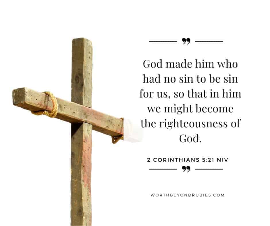 An image of a wooden cross on a white background with 2 Corinthians 5:21 quoted