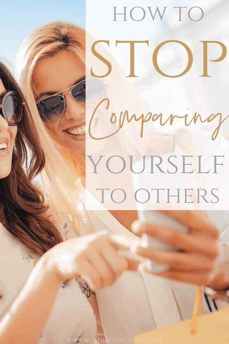 The Comparison Trap and What the Bible Says About Comparing Yourself to Others - Two Woman with sunglasses on and shopping bags on their arms looking at a cell phone and pointing at it smiling