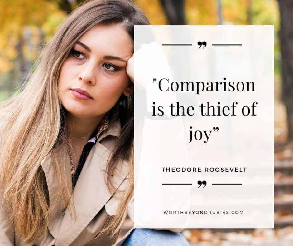 "An image of a woman with long brown hair in a trench coat sitting on a park bench looking sad and a text overlay that says ""Comparison is the thief of joy - Teddy Roosevelt"" - The Comparison Trap"