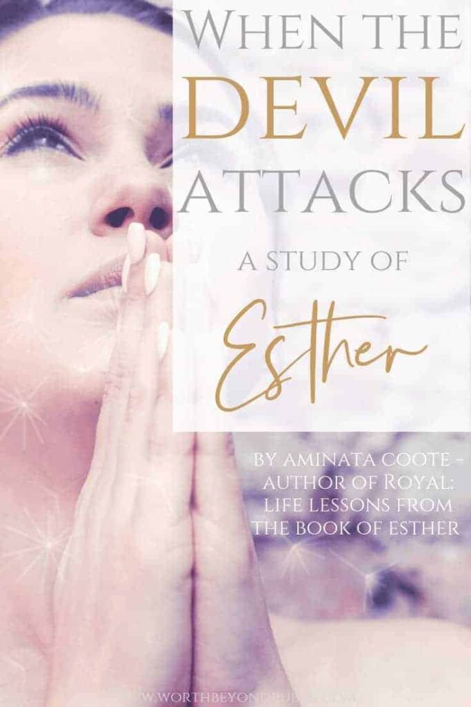 When the Devil Attacks - A study of the Book of Esther - a woman with her hands held in prayer looking up toward Heaven
