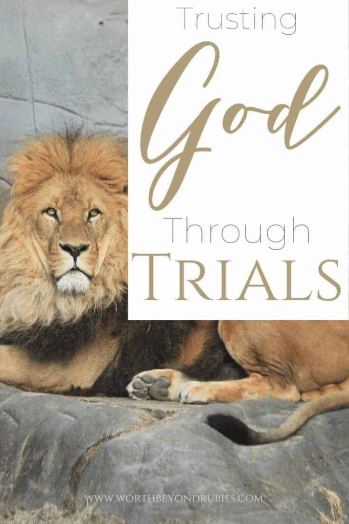 A lion lying in his den with a text overlay that reads 'Trusting God through Trials - Where is God?""