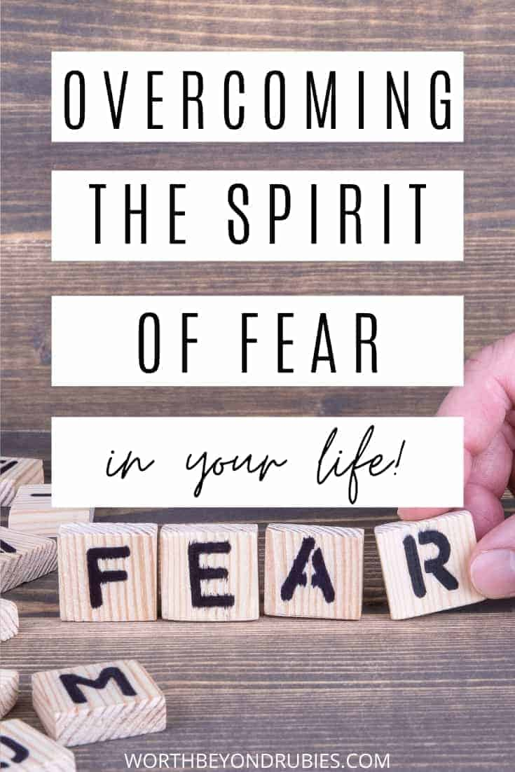 Scrabble type tiles spelling out fear with a hand placing the R in place and a text overlay that says Overcoming the Spirit of Fear
