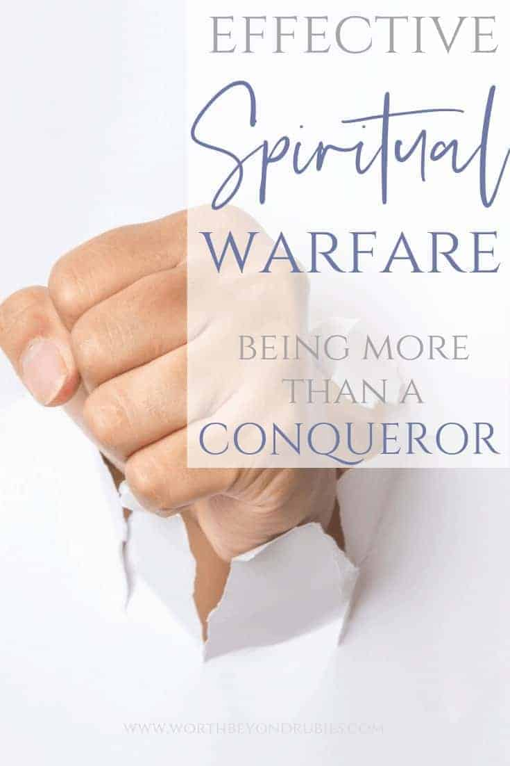 Effective Spiritual Warfare - Being More Than a Conqueror in Christ - a fist punching through a white paper wall