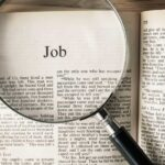 "The Book of Job under a magnifying glass for post entitled The Book of Job under a magnifying glass and text that says Job Bible Study - His ""Unshakable"" Faith in His Redeemer"