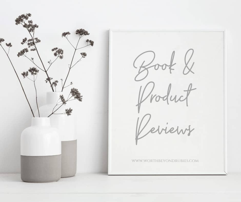 Christian Book and Product Reviews - A plant and a white canvas sign that says Christian Book and Product Reviews