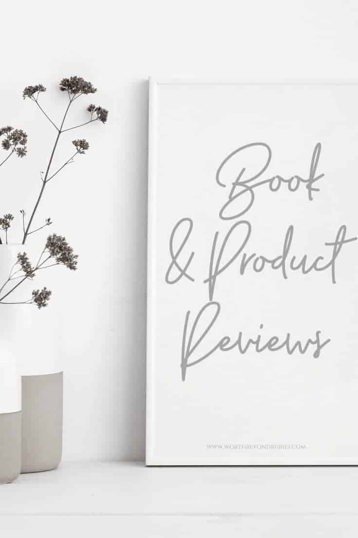 Christian Book Reviews - A plant and a white canvas sign that says Christian Book Reviews