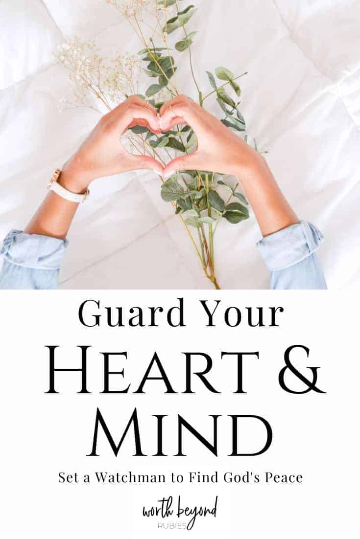 A woman's hands in the shape of a heart over a bed with a large sprig of baby's breath on it and a text overlay that says Guard Your Heart and Mind to Set a Watchman and Find God's Peace