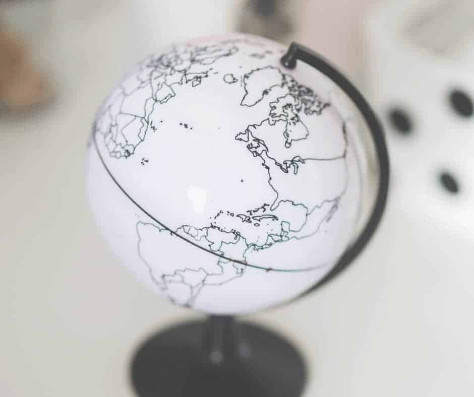 Not of This World - Having one foot in the Kingdom and one in the World - An image of a white globe