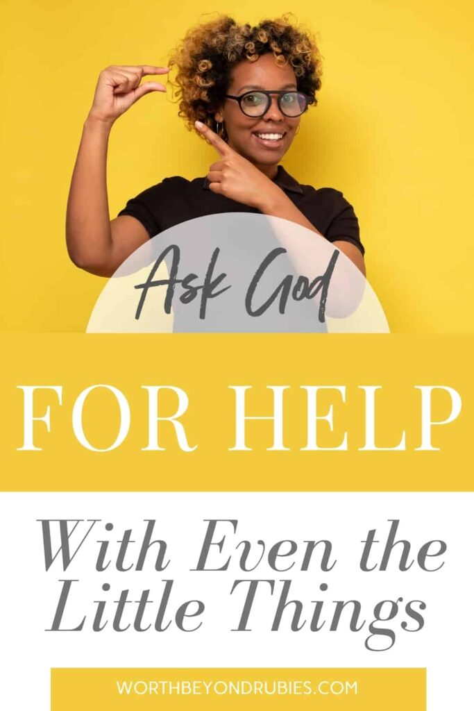 Beautiful, smiling black woman shows something small with hands against yellow background - Text that says Ask God for Help With Even the Little Things