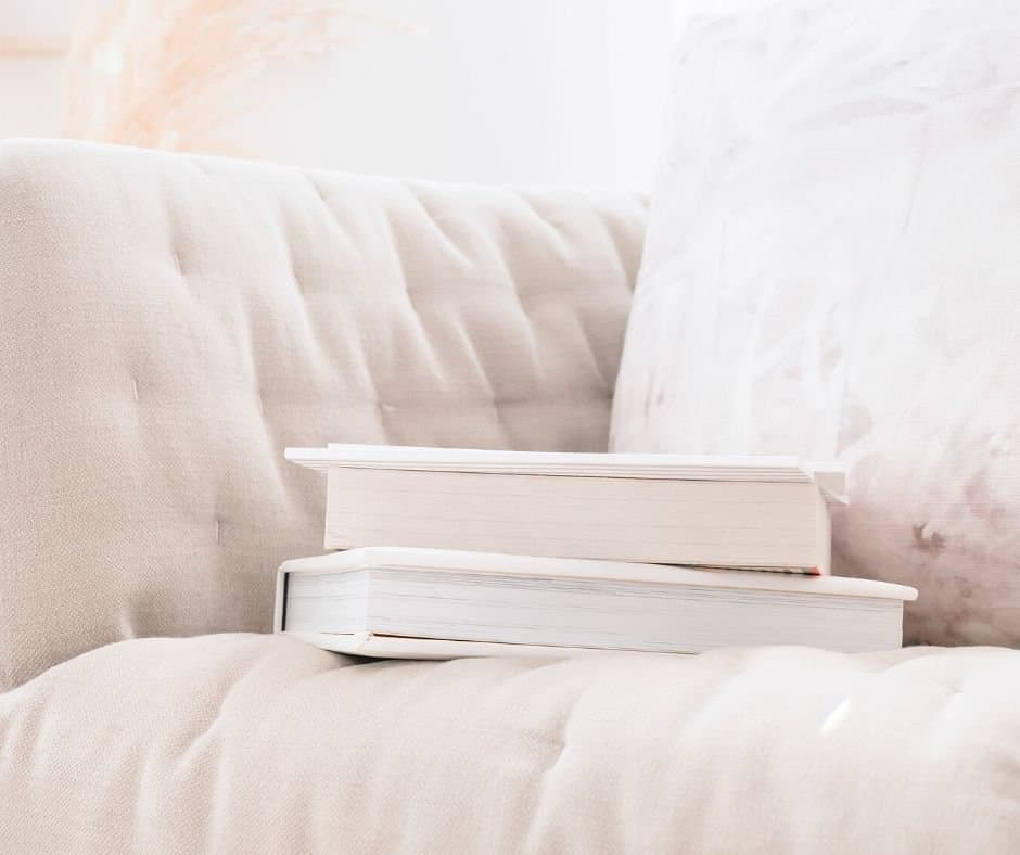 An image of a white couch with white books on it