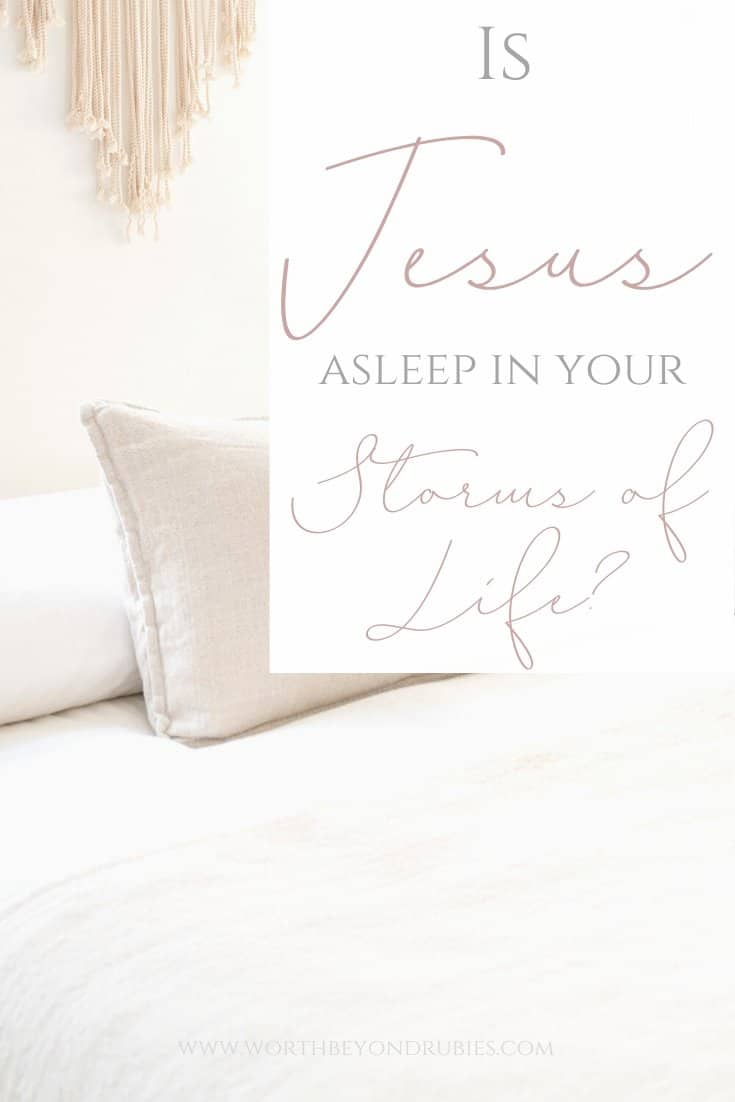 An image of a white bed with beige throw pillows on it and a text overlay that says Is Jesus Asleep in Your Storms of Life?