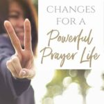 A woman smiling holding up her fingers in a peace sign with a text overlay that says Make 2 Changes for a Powerful Prayer Life