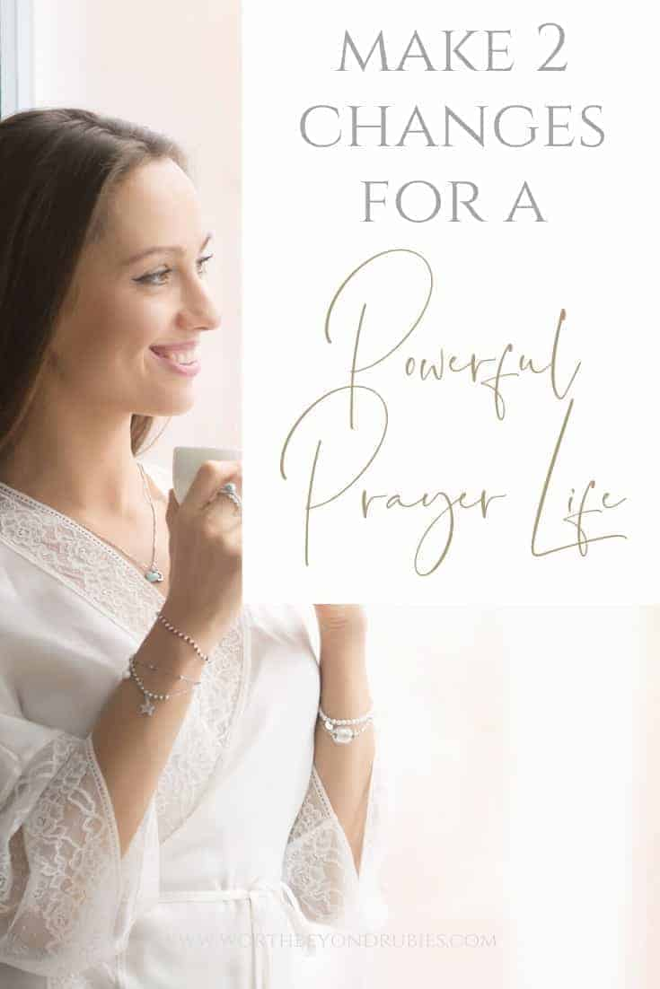 "A woman smiling looking out a window with a cup of coffee and a text overlay that says ""Make 2 Changes for a Powerful Prayer Life"""