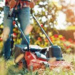 Building a Relationship With God - Are You Just Mowing God's Lawn - an image of a person in a red shirt pushing a red lawn mower in the grass