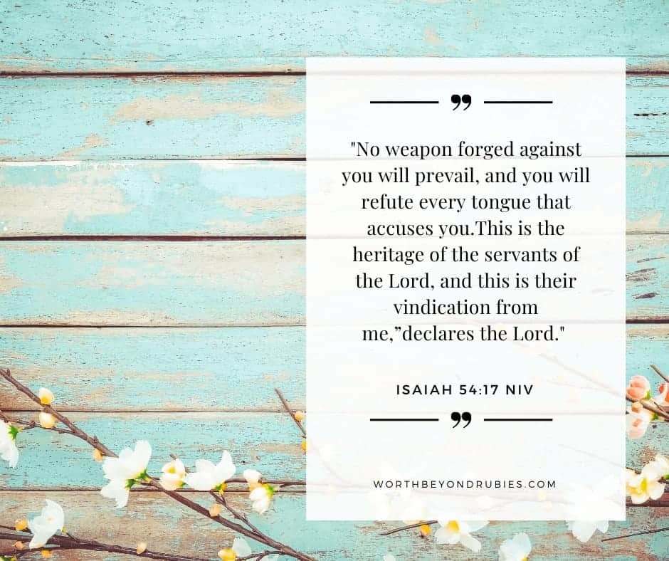 A blue green wooden background with cotton and Isaiah 54:17 quoted