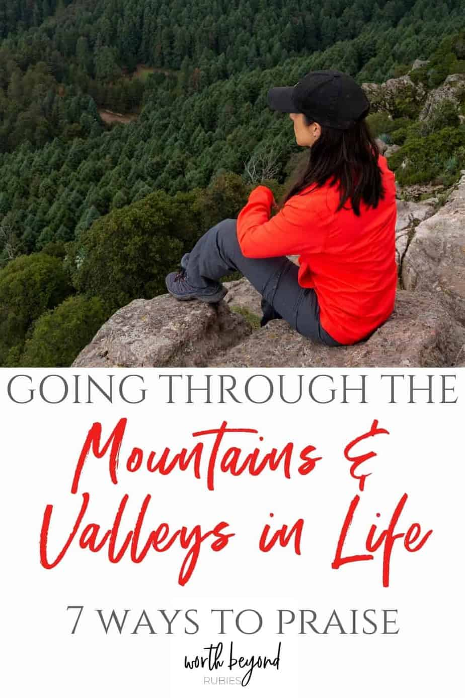 Woman in red shirt sitting on a mountain and text that says Going Through the Mountains and Valleys in Life - 7 Ways to Praise