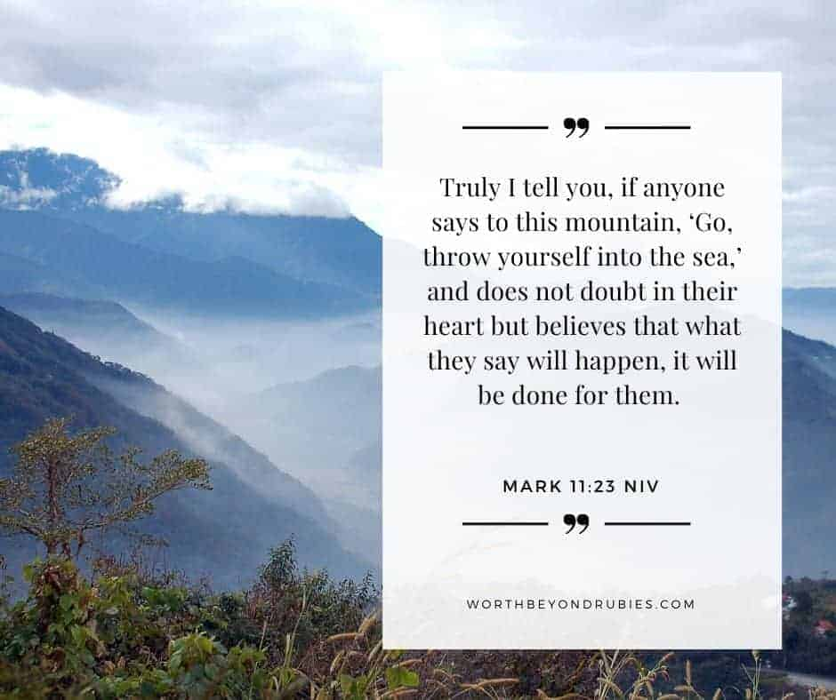 An image of a mountain range covered in mist and Mark 11:23 quoted