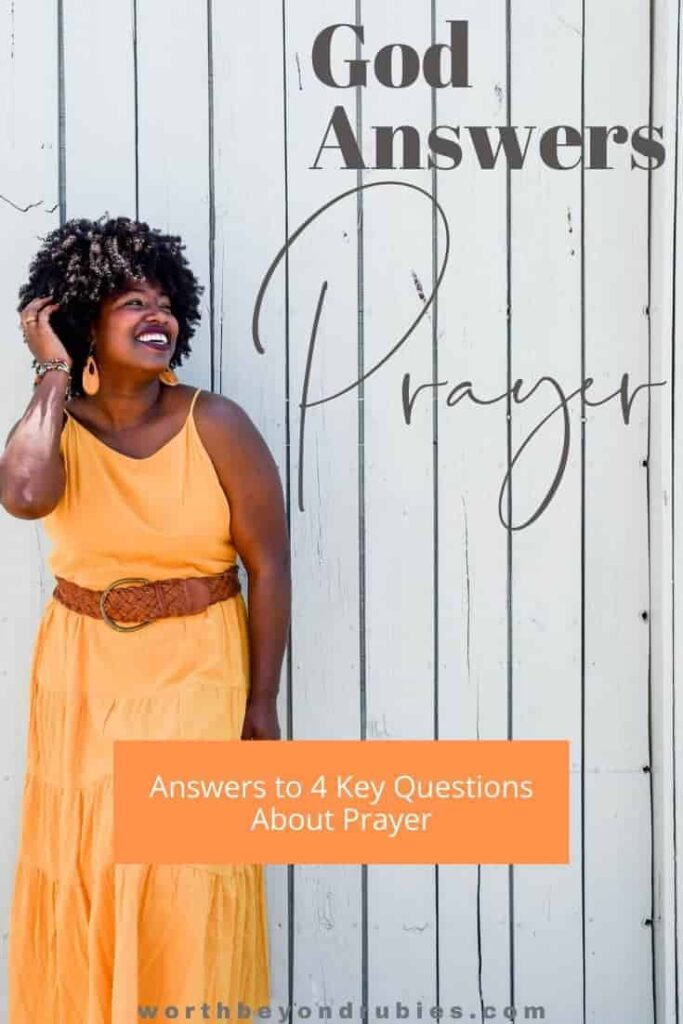 "A woman in an orange dress against a whitewashed wooden wall and a text overlay that says ""God Answers Prayer'"