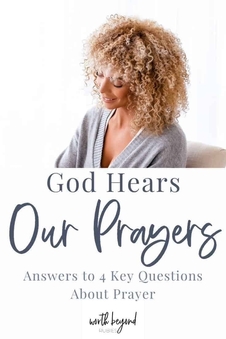An image of a beautiful black woman with blonde curls in a gray sweater, looking down and text overlay that says God Hears Our Prayers - Answers to 4 Key Questions About Prayer