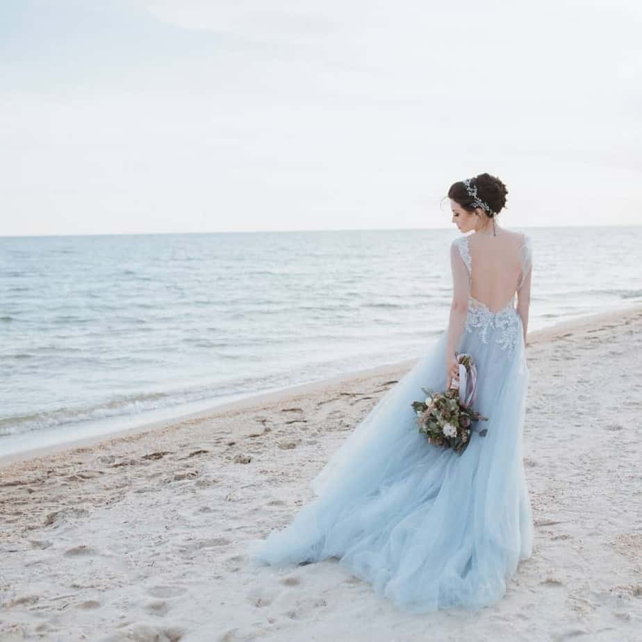 An image of a bride on the beach